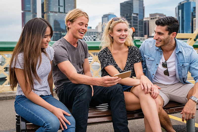 4 young friends at darling harbour